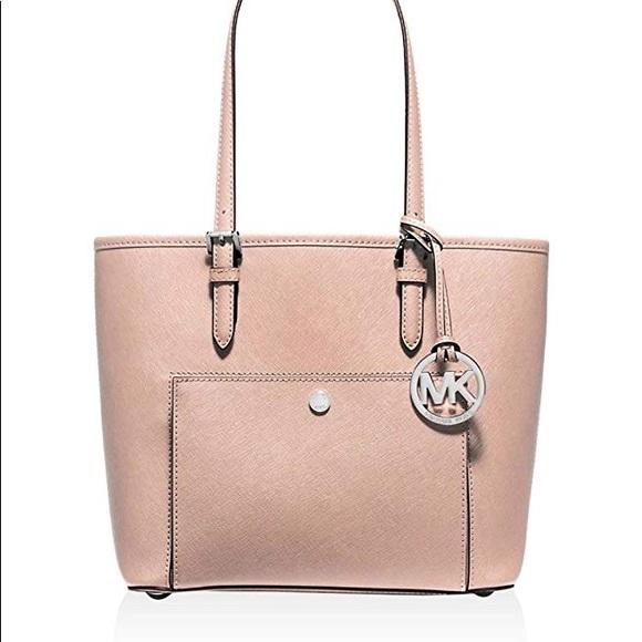 46d539a26 Michael Kors Bags | Jet Set Item Md Tz Snap Pocket Tote | Poshmark